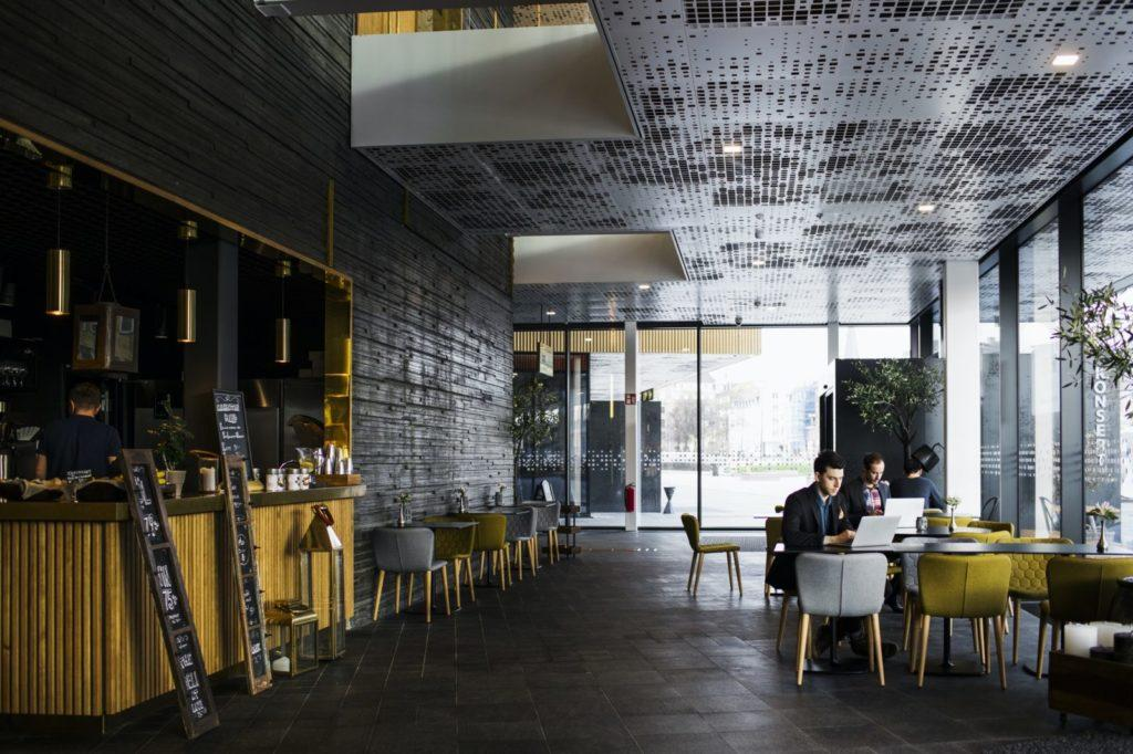 Businessmen sitting at tables in restaurant